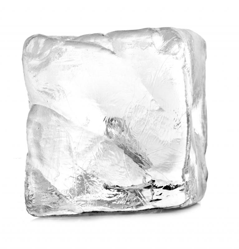 An ice cube can be used to remove glue from carpet.
