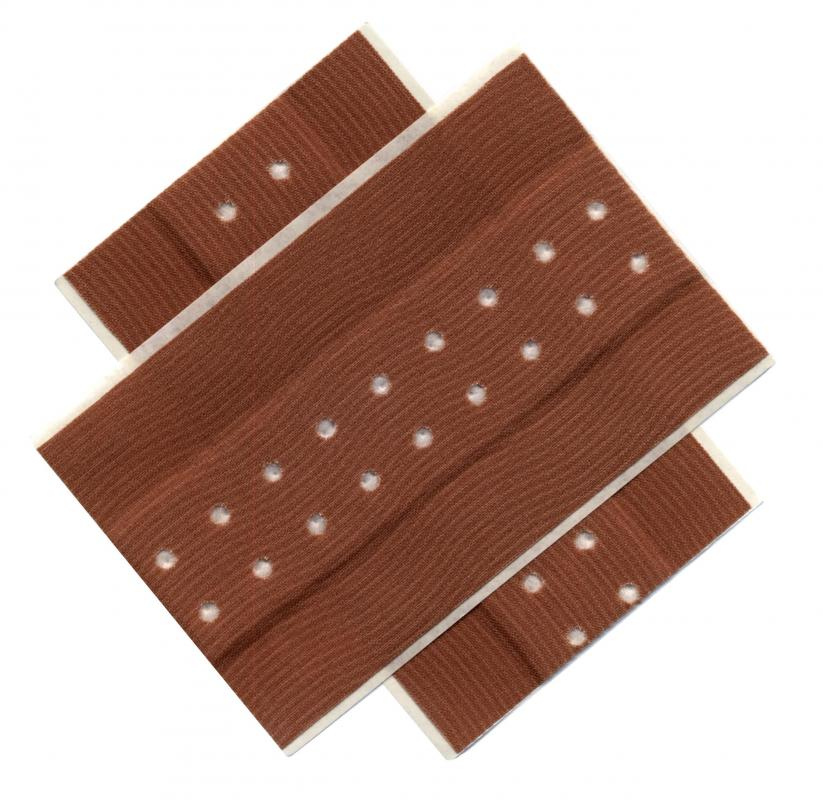 Adhesive bandages are sometimes used with sterile dressing to treat wounds.