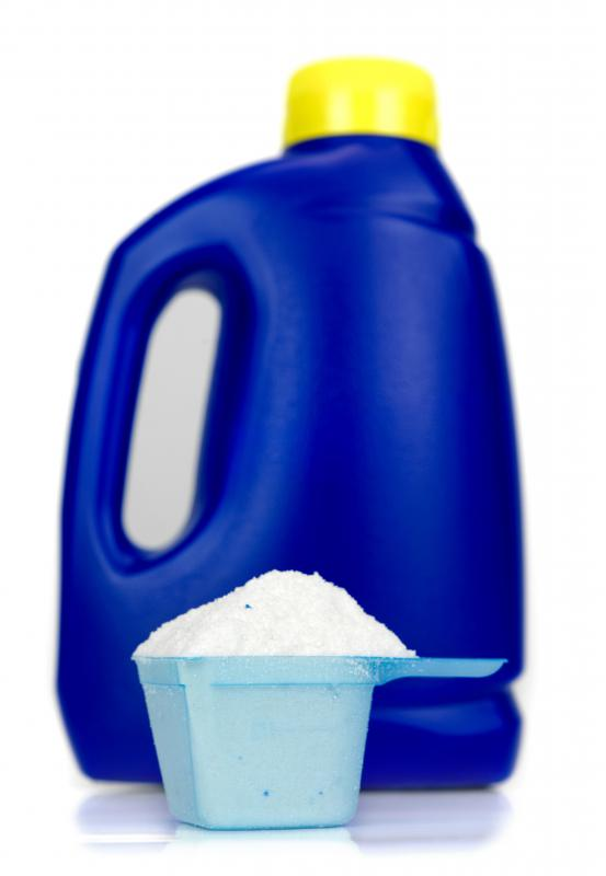 A bottle and cup of laundry detergent.