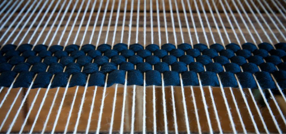 Loom with white warp and blue weft.