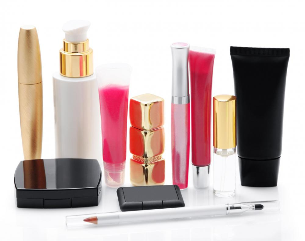 Several different types of makeup, including mascara, lipstick, and eyeliner.