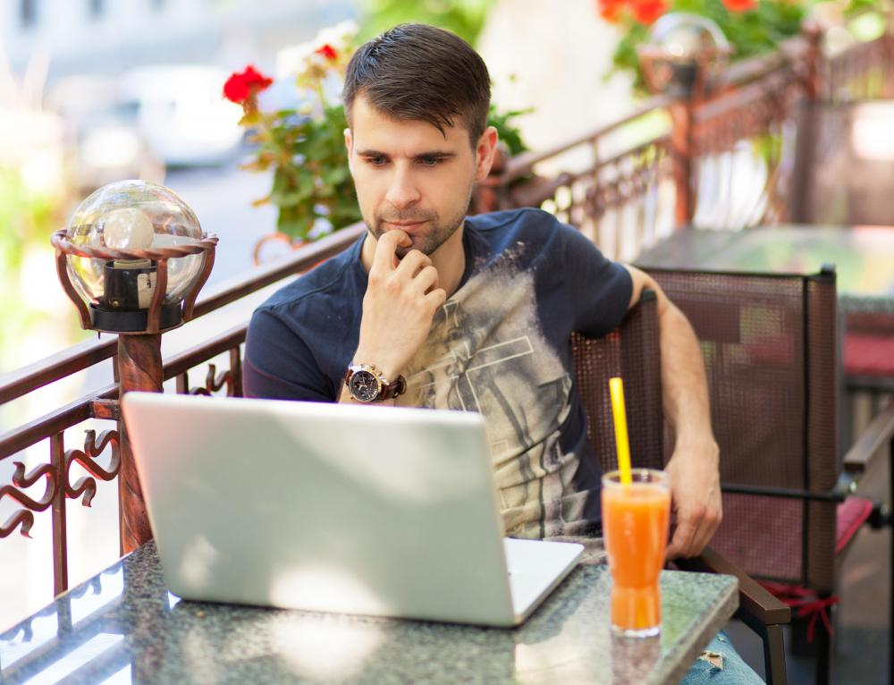 Using a laptop, telecommuters may be able to continue regular work schedules while on vacation.