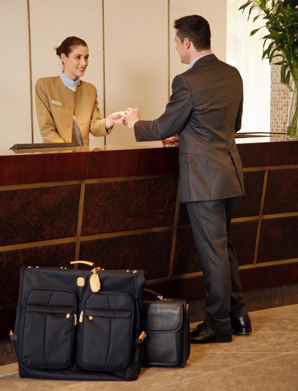 A hotel front desk agent is often responsible for checking guests in and out of the hotel.