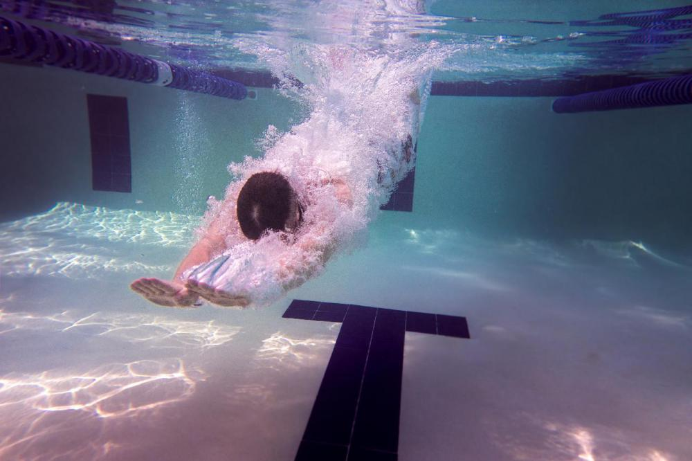 "Octopush, or Underwater Hockey, is generally played in a swimming pool with a weighted puck and ""pusher sticks.""."