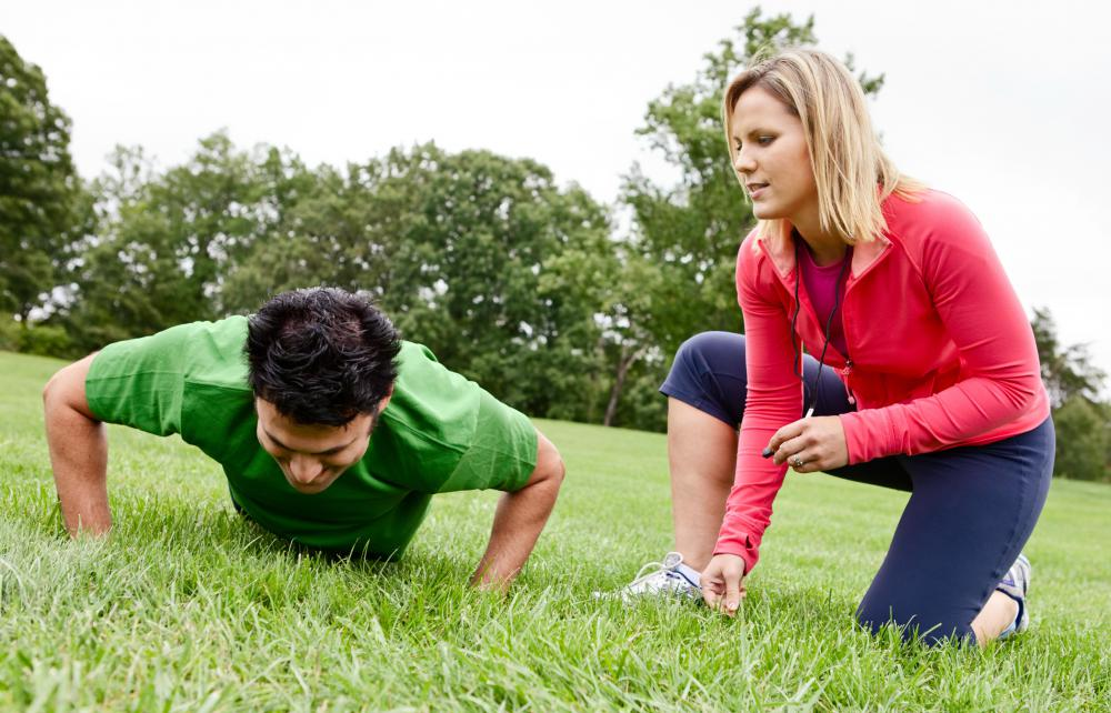 A personal trainer may help guide a person through circuit training.