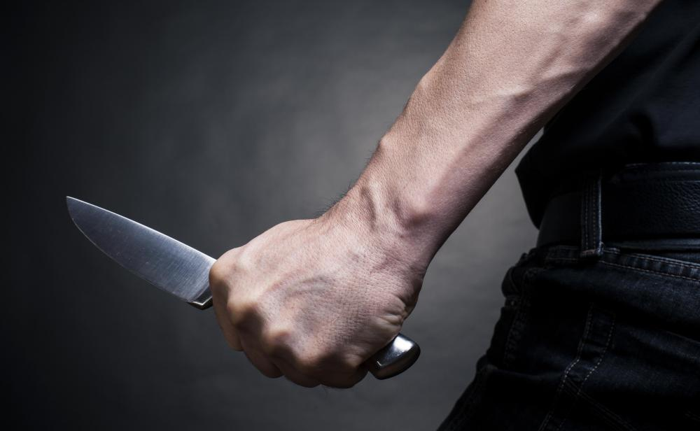 Waving a knife at someone is an example of automatic assault.