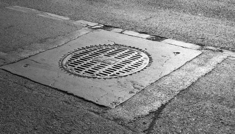 Manholes often provide access to sewers from street level.