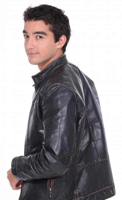Man in a leather jacket with a patina on it.