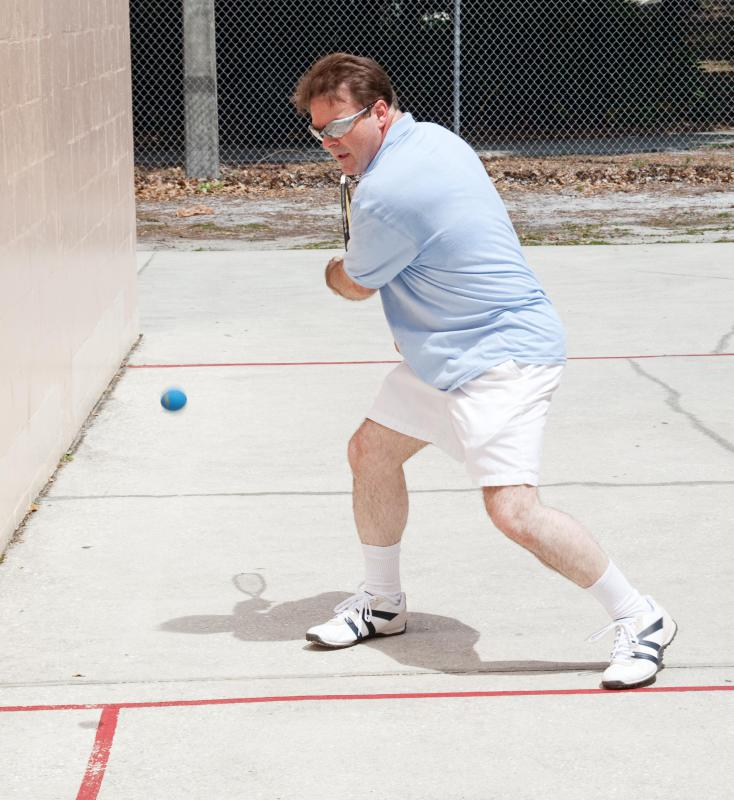 Racquetball is a sport similar to tennis that's played with a rubber ball and wooden rackets.