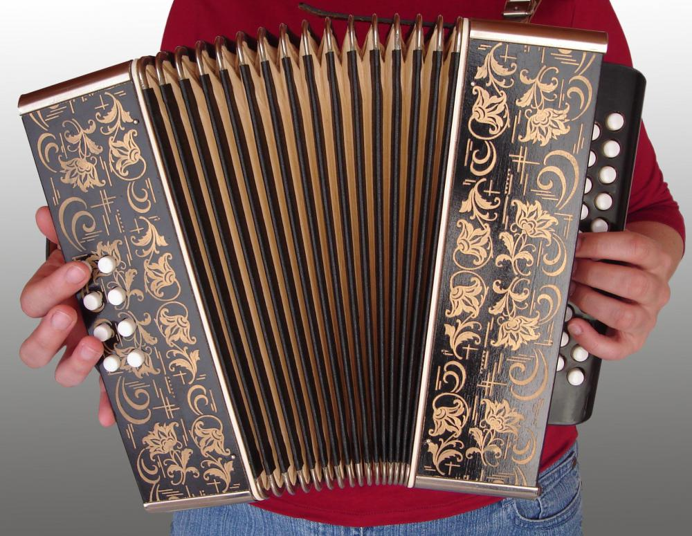 Button accordions feature buttons in place of piano keys and are often smaller and more portable than the standard accordion.
