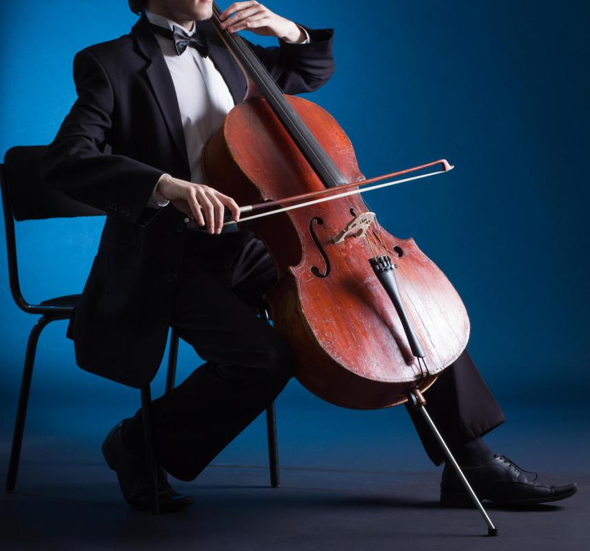Cellos are most often made of wood, and have the same general shape as a violin.