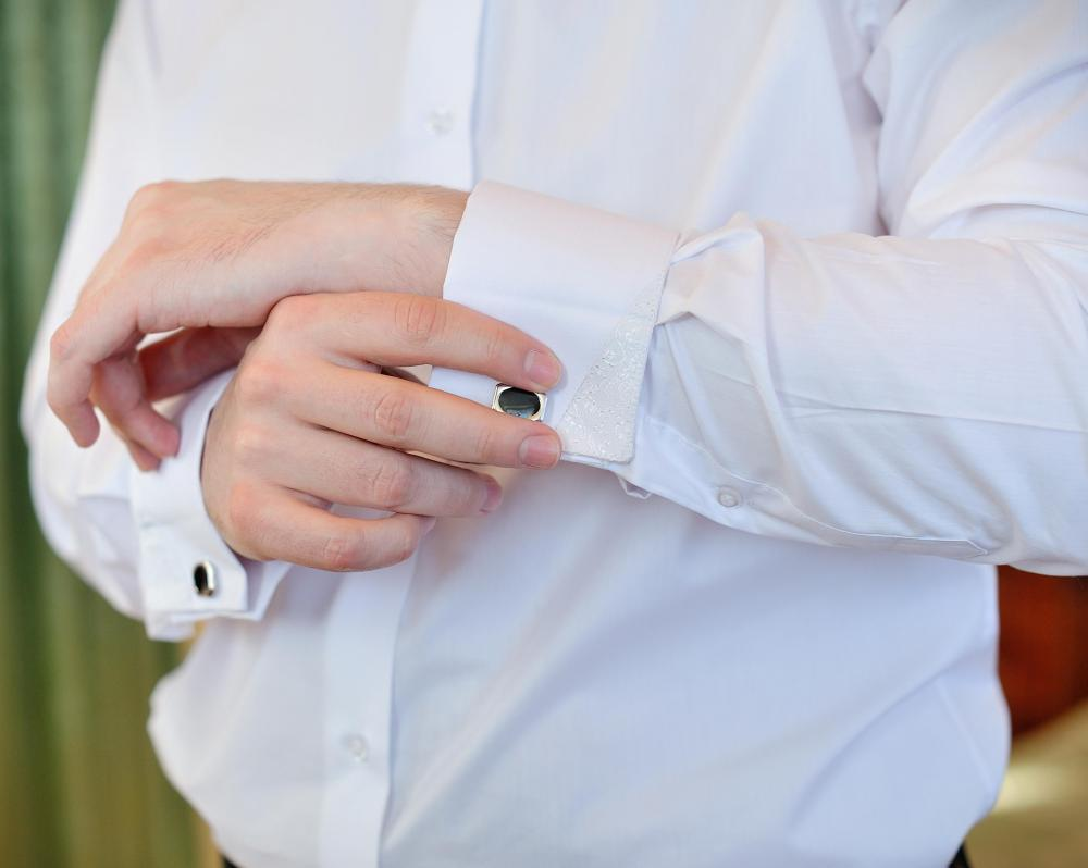 Cufflinks are items of male jewelry that are used in dressy shirts in lieu of buttons on the sleeves.
