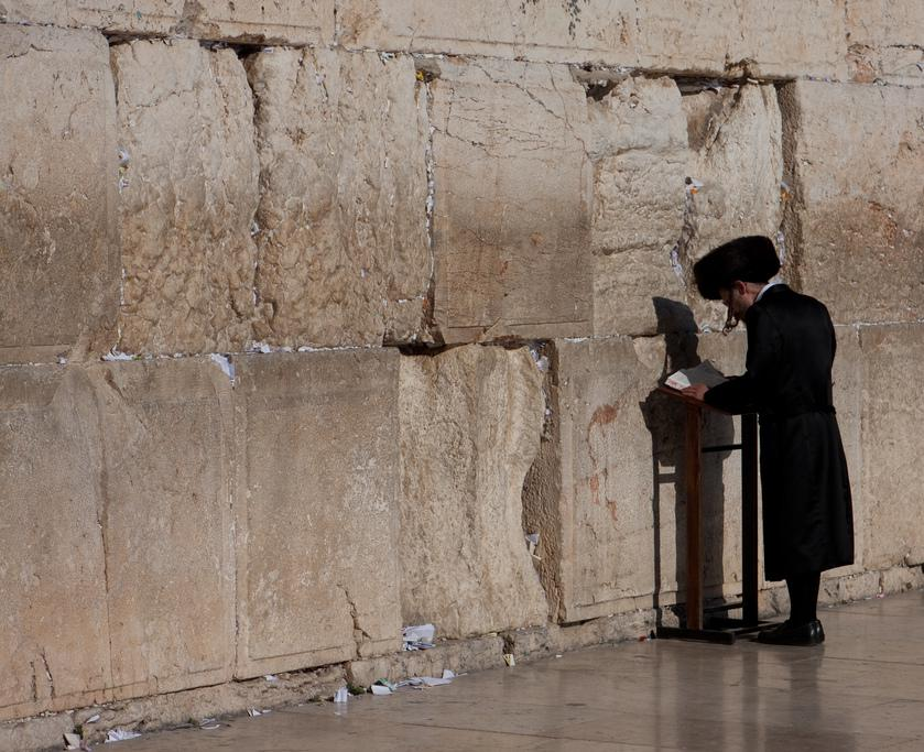 Hassidic man praying at the Kotel (Western Wall) in Jerusalem.