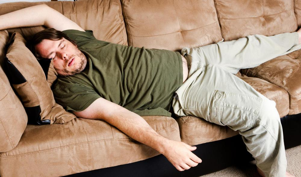 Falling asleep on the couch in a poor position can lead to back pain.