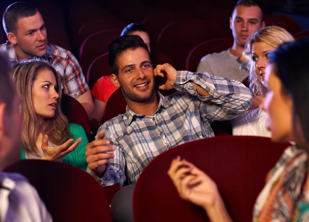 Talking on a cell phone in a theater is considered extremely rude.