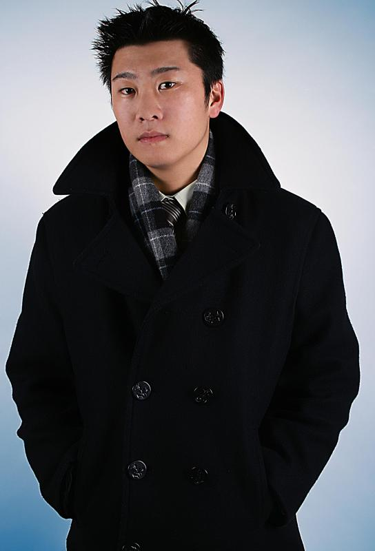 Men typically pair a scarf with a collared jacket.