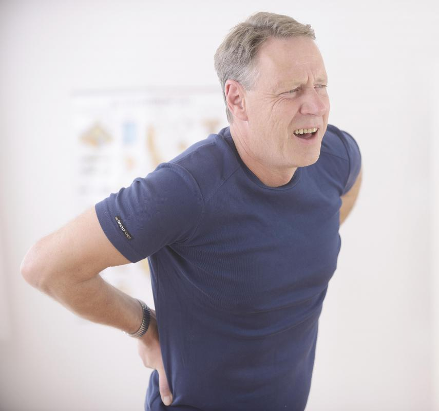A spinal disc herniation can cause back spasms.