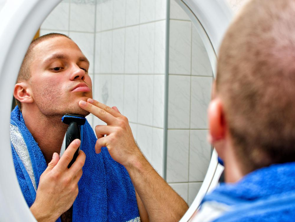 Acne shampoo can be used to treat facial pimples on a man's face as well as scalp.
