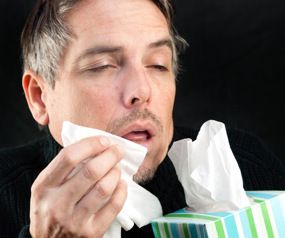 Using a tissue when sneezing is considered a good manner.