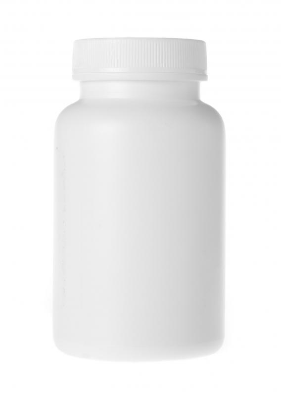 A bottle of OTC painkillers, which can help with sinus and jaw pain.
