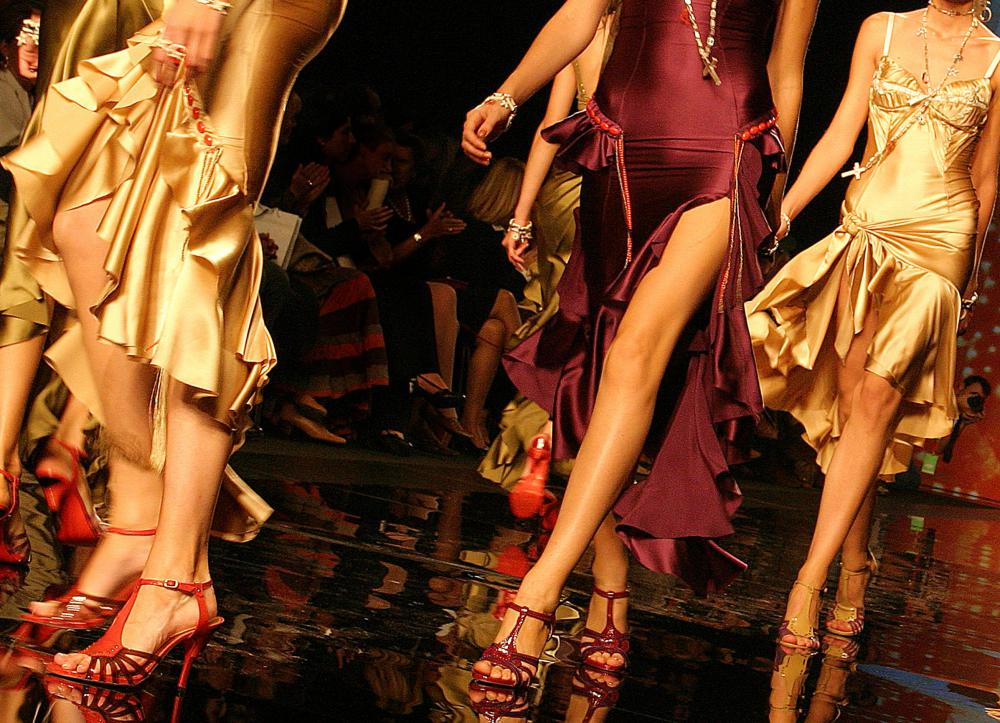 At a fashion show, a catwalk is a long and narrow stage for models to display clothing.