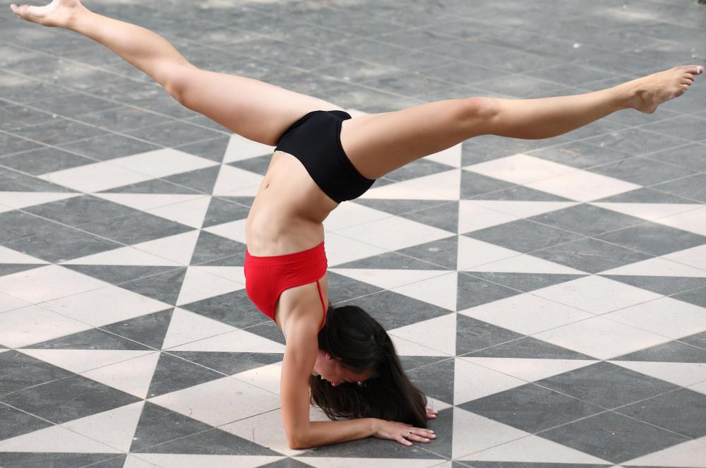 Gymnastics become a form of dance when music and dance steps are added.
