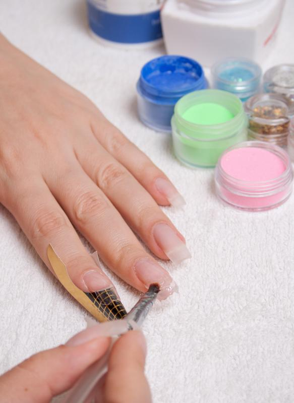 Priming the nails is done to help the acrylic adhere to the nail bed.