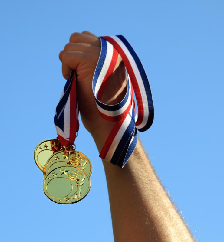 An Olympic gold medal is symbolic of grand achievement.