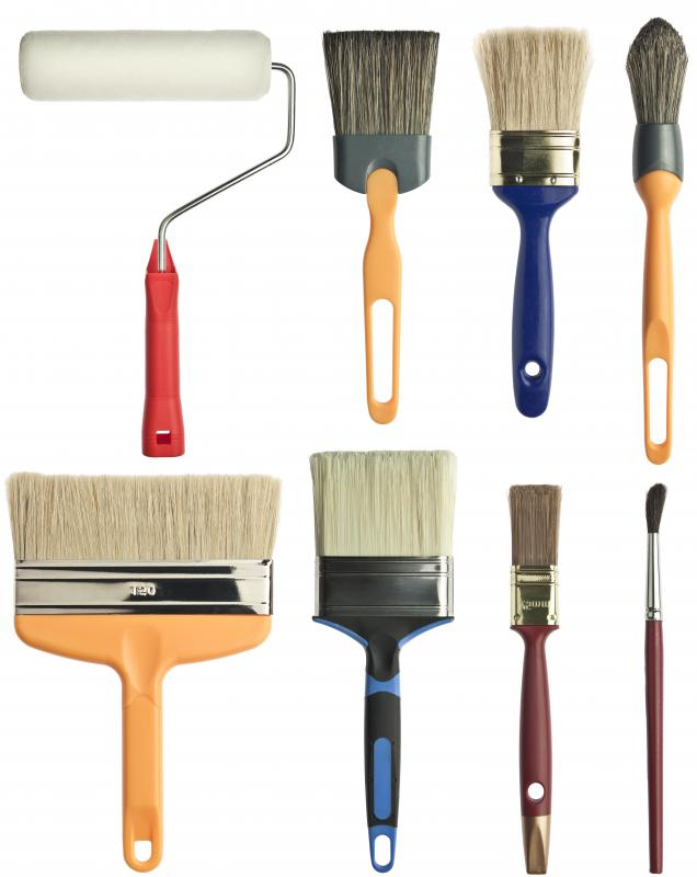 Different types of brushes are used depending on the wall size and desired effect.