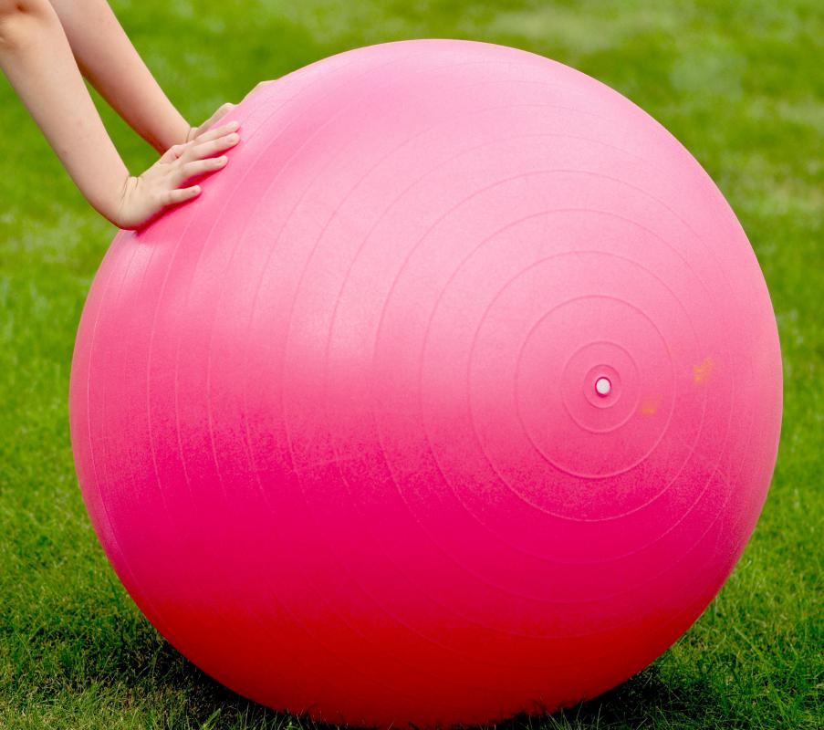 An exercise ball is a popular form of exercise equipment.