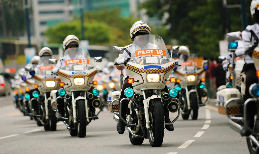 Three-quarter shell helmets are commonly worn by police who ride motorcycles.
