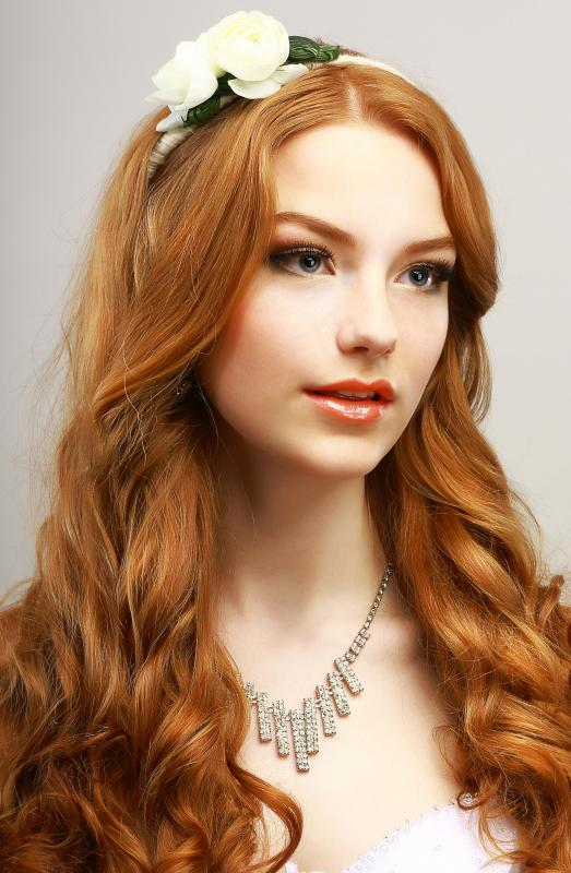 Rose oil can help hair retain its luster by preventing it from drying out.