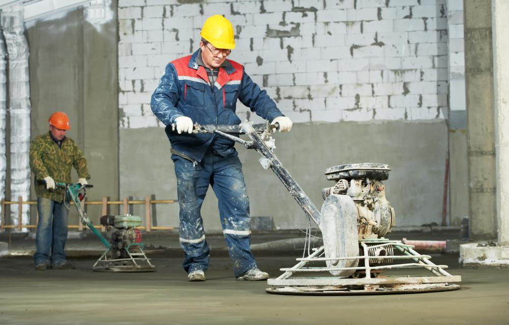 Power trowels might be used to impart a smooth surface finish on freshly poured concrete slabs.