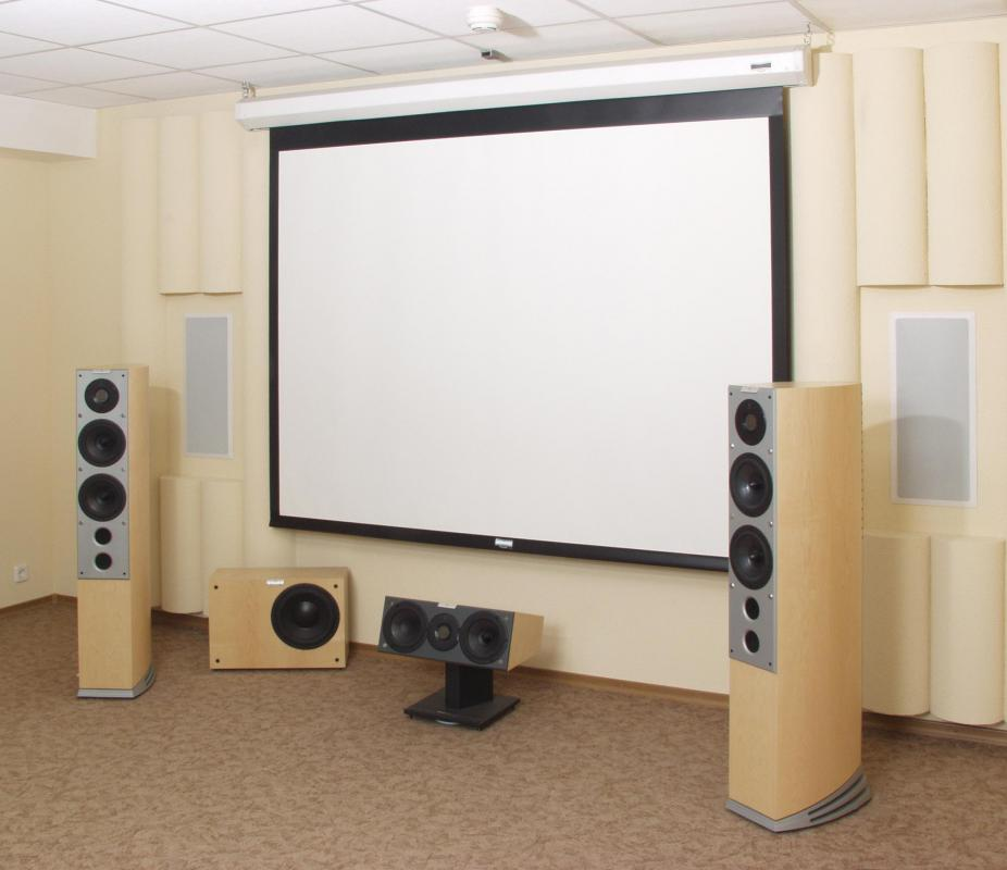 Soundproof curtains can be used to reduce outside sounds from coming into a home theater.