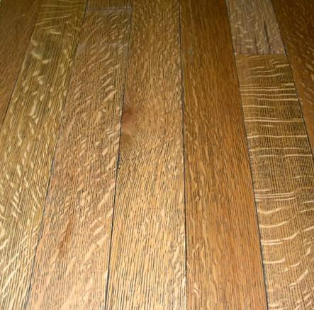 Wood floors should be cleaned with a damp mop.