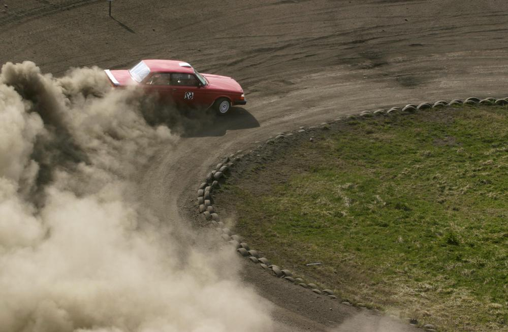 Rally cars are raced on dirt tracks.