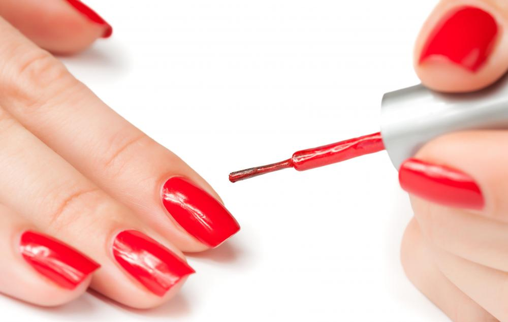 An allergic reaction to fingernail polish might cause white spots on nails.