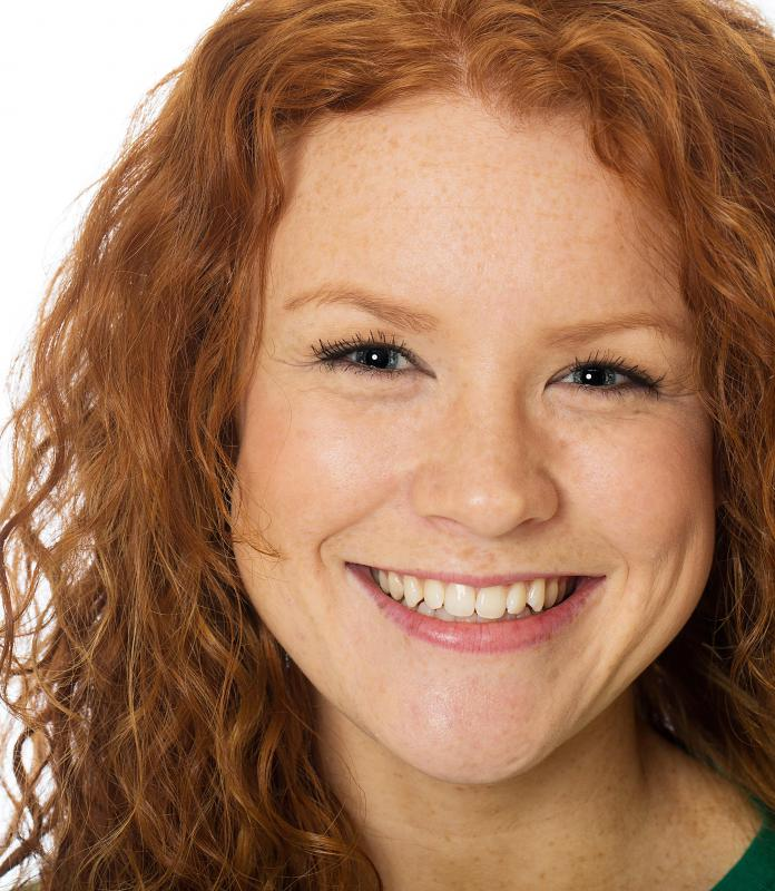 People with red hair often have fair skin and freckles.