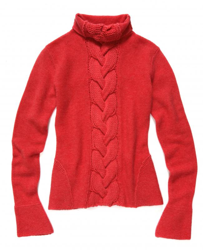 A red sweater made from acrylic yarn.