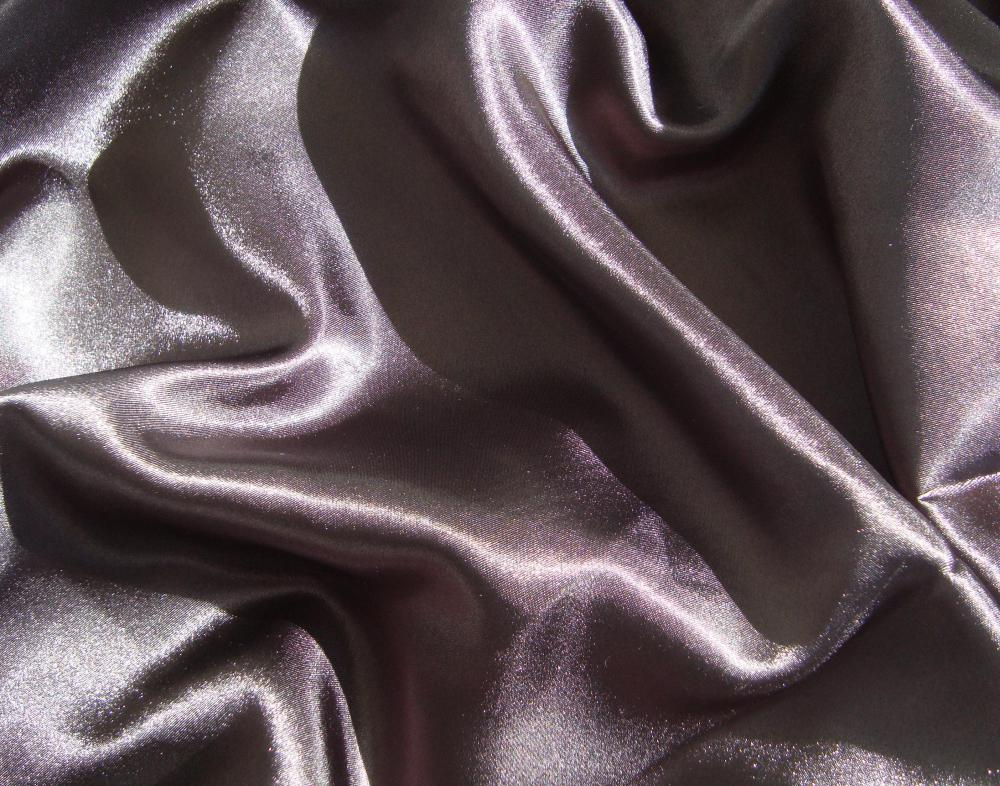 A closeup of a sateen sheet.