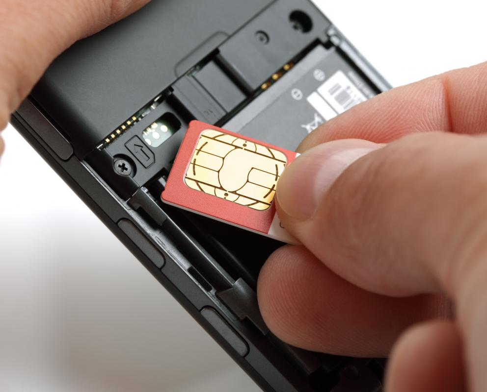 SIM card being placed into a GSM mobile phone.