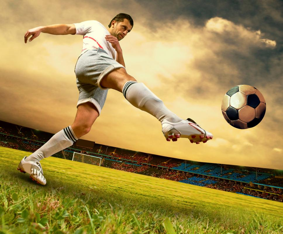 Soccer player kicking the ball.