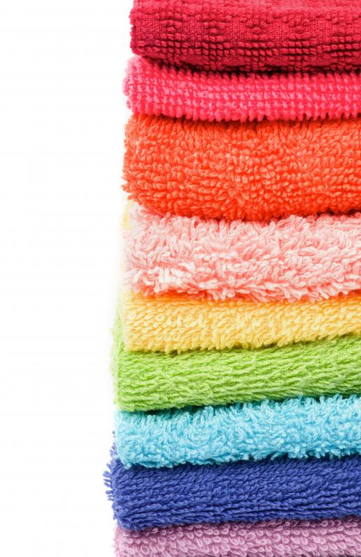 Keep an old bath towel handy when repairing linoleum.