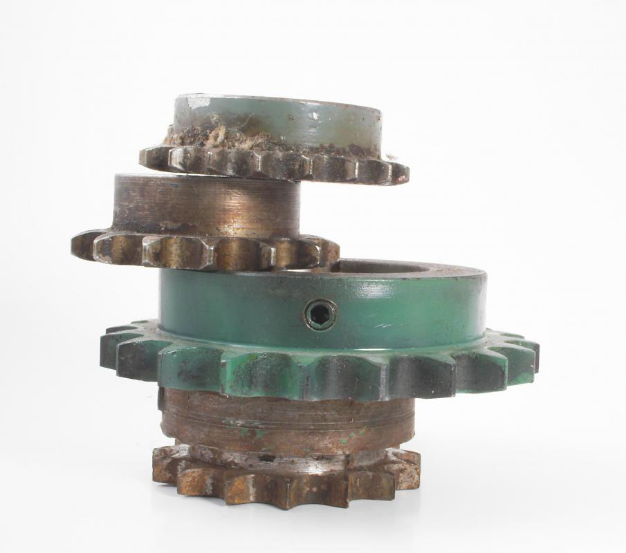 A cam sprocket is attached to a camshaft in a combustible engine to help maintain timing.