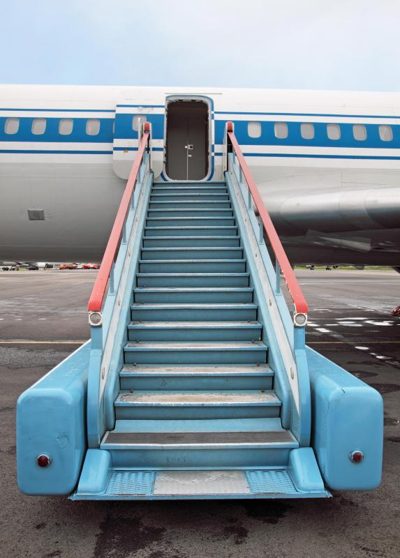 Stairs leading up to an airplane door.