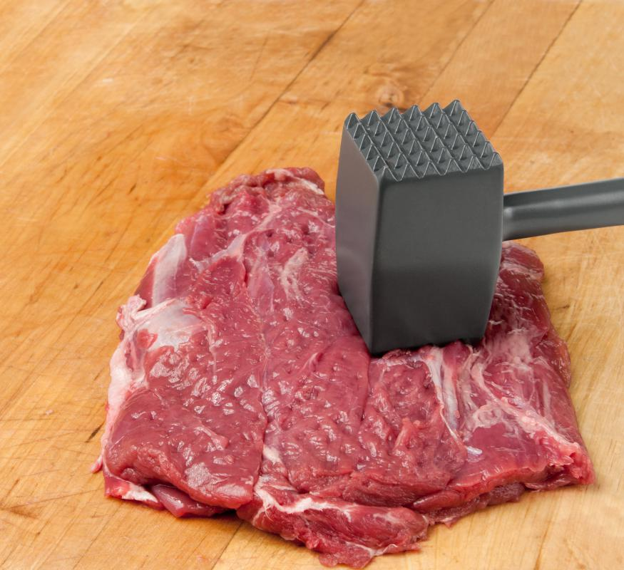 A meat tenderizer with a steak.