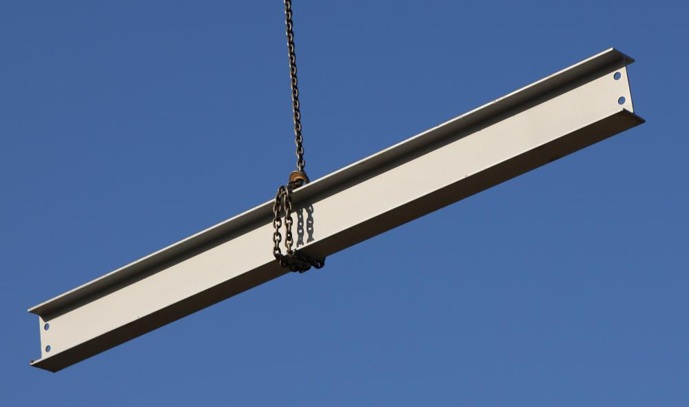 Steel I-beam lifted by a crane.