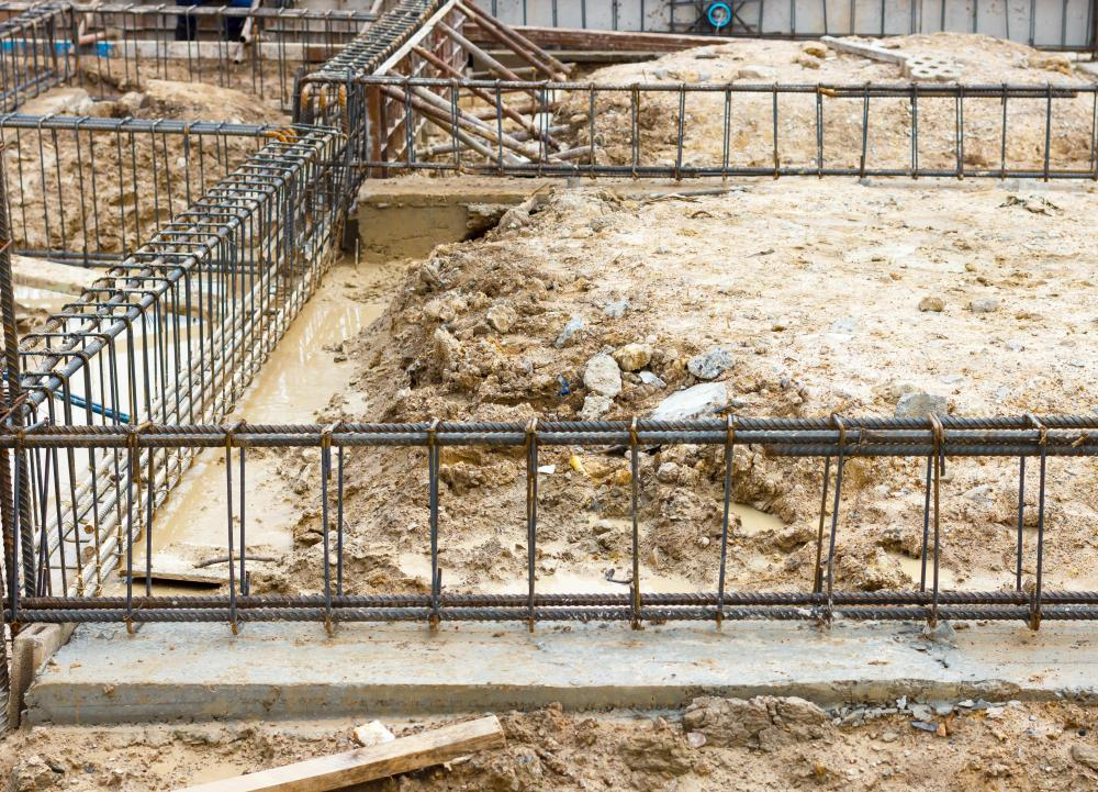 Concrete and metal reinforcing bars, or rebar, are used to construct spread footings.