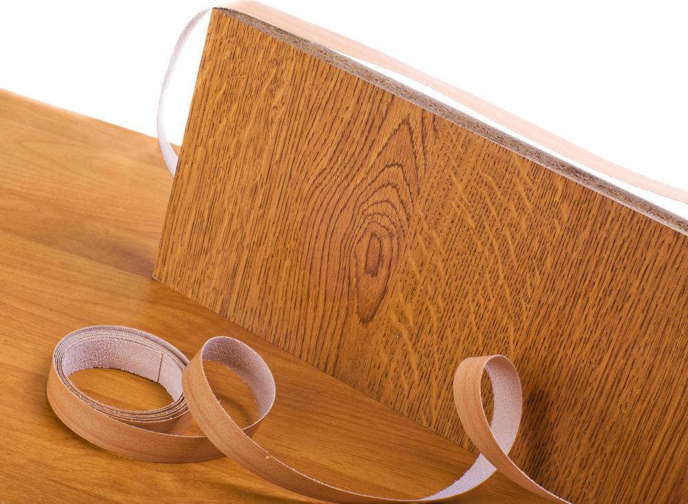 Some furniture manufactures use particle board covered with veneer instead of natural hardwoods.