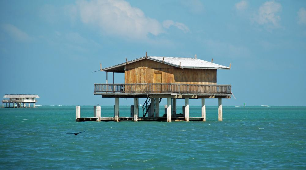 Stilt houses are designed to avoid flooding and accommodate high tide.
